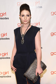 Michelle Trachtenberg wore an Erickson Beamon necklace, ring and earrings at the 'Gossip Girl' 100th episode party.
