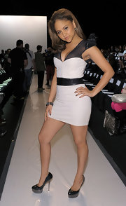 Kat DeLuna showed off a leather clad cocktail dress while hitting the Gottex fashion show.