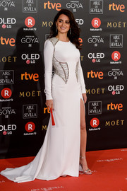 Penelope Cruz worked a flowing white Atelier Versace gown with a chain-embellished bodice and a thigh-high slit at the 2018 Goya Cinema Awards.