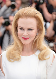 Nicole Kidman went for retro charm with this bouffant-style 'do with wavy ends during the 'Grace of Monaco' photocall.