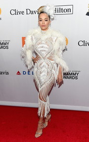 Rita Ora got majorly fancy in a fringed and feathered white dress by Zuhair Murad Couture at the Grammy Salute to Industry Icons.