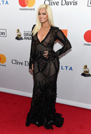 Bebe Rexha sheathed her figure in a sheer, beaded lace gown by Naeem Khan for the Grammy Salute to Industry Icons.