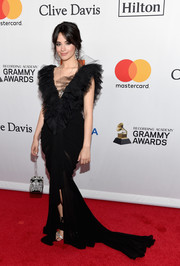 Camila Cabello went ultra feminine in a black Ester Abner fishtail gown with a heavily ruffled neckline at the Grammy Salute to Industry Icons.