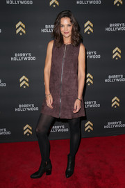 Katie Holmes paired her dress with chunky-heeled ankle boots.