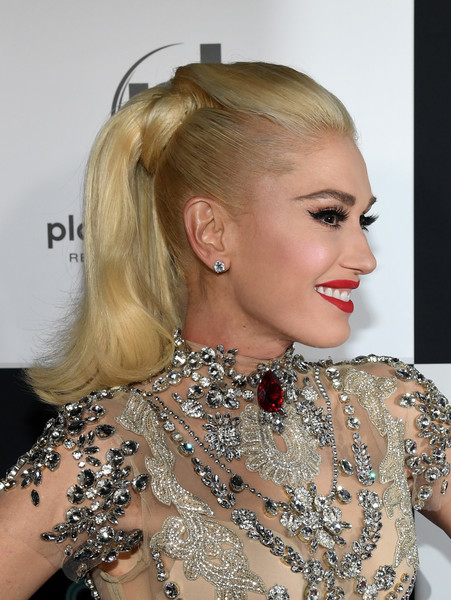 Gwen Stefani matched her rhinestone-embellished dress with a pair of diamond studs.