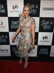 Gwen Stefani unleashed her inner Vegas showgirl in a sheer dress with silver fringe and beading at the grand opening of her 'Just a Girl' residency.