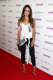 Jordana Brewster teamed her top with black skinny jeans by J Brand.