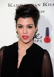 Kourtney Kardashian wore her hair in a casually tousled updo at the opening of Kardashian Khaos in Las Vegas.