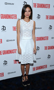 Kelsey Chow went for a soft feminine look with this sleeveless white lace dress.