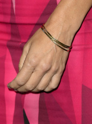 Sandra Bullock went for minimal styling with these simple gold bangles during the 'Gravity' press conference.