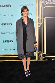 Carey Lowell's wool coat looked totally evening appropriate with its embellished trim.