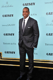 Jay-Z showed off his dapper style with this gray checked suit.