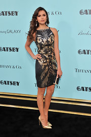 Nina Dobrev stunned in metallics when she wore this patterned beaded dress to the premiere of 'The Great Gatsby.'