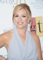 Leigh Anne Tuohy wore a light chain necklace with a small diamond pendant at the GTN anniversary party.