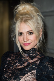 Pixie Lott went wild with this super-messy bun at the Green Carpet Challenge BAFTA Night.