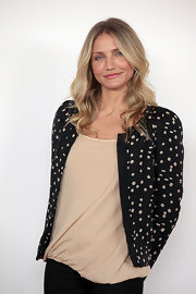 Cameron Diaz showed off long curls while attending the photo call for 'The Green Hornet'.