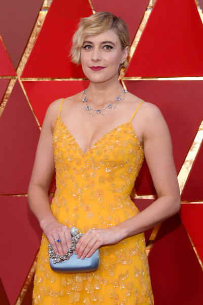 Greta Gerwig Satin Purse [yellow,orange,clothing,beauty,hairstyle,dress,fashion,flooring,neck,photography,arrivals,greta gerwig,academy awards,hollywood highland center,california,90th annual academy awards]