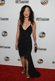 Sandra Oh showed off her vampy side in a black slip dress with a high-low hem at the 'Grey's Anatomy' 200th episode celebration.