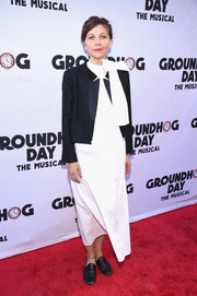 Maggie Gyllenhaal styled her simple frock with a cropped tuxedo jacket.