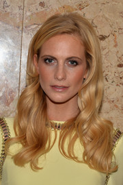 Poppy Delevingne looked every inch a blonde bombshell with her long wavy locks at a Gucci beauty event.
