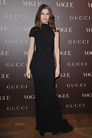 Laetita looked daringly elegant in a black floor length evening gown at the Gucci Rue Royale Reopening party.