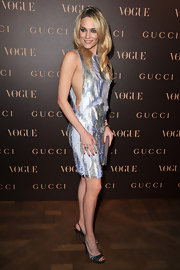 Laura Chiatti dazzled at the Vogue Paris dinner in satin pewter slingback platforms.