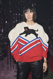 Eva Chen attended the Gucci fashion show sporting a puff-sleeved panther-print sweater from the brand.