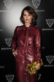Violante Placido arrived at the opening of the Gucci Museum in Florence dressed in a daring red leather dress.