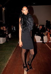 Super model Chanel Iman showed off the fall season's hottest trend, a cocktail dress pluming with feathers.