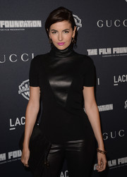 Camilla Belle attended the restoration premiere of 'Rebel Without a Cause' wearing a pair of gold bamboo bracelets by Gucci.