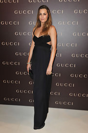 Yasmin wears a black cut-out evening dress for the Gucci party in Paris.