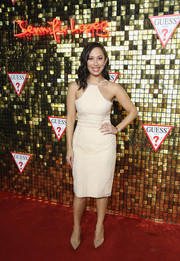 Cheryl Burke was sexy and sophisticated in a nude halter dress at the Guess Spring 2018 campaign reveal.