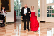 Deborah Dingell wore this strapless red dress with a bowed waist to the White House State Dinner.