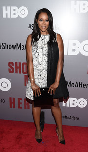 June Ambrose was modern and edgy at the 'Show Me a Hero' screening in a splatter-print tent dress with draped black fabric cascading down one side.