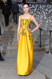 Tao Okamoto's yellow gown, featuring golden leaf-like embellishments, gave the young star almost a regal look.