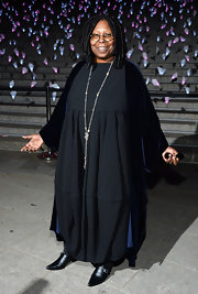 Whoopi Goldberg kept her evening look simple with this oversized gray dress.
