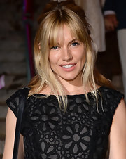 Sienna Miller chose a slightly undone half up, half down 'do for her look at the Vanity Fair Party in NYC.