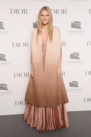 Gwyneth Paltrow's ombre Dior cape and pleated gown at the Guggenheim International Gala Dinner were an elegant pairing!