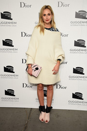 Elisabeth von Thurn und Taxis bundled up in a loose white sweater dress for the Guggenheim International Gala Pre-Party.