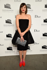 Marion Cotillard cut a dramatic silhouette in a Dior strapless LBD with a layered, flared skirt during the Guggenheim International Gala pre-party.