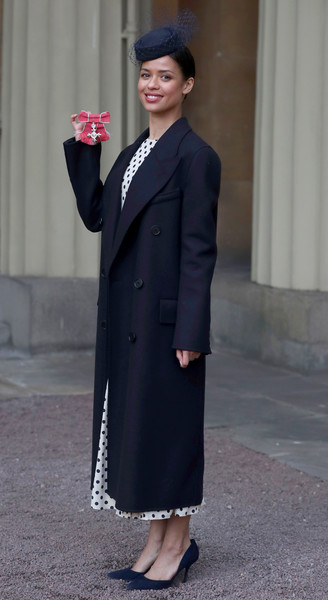 Gugu Mbatha-Raw Pumps [doctor who,clothing,coat,suit,formal wear,overcoat,outerwear,trench coat,tuxedo,snapshot,fashion,actress,investitures,mbe,investiture,buckingham palace,gugulethu mbatha-raw,england,prince of wales,ceremony]