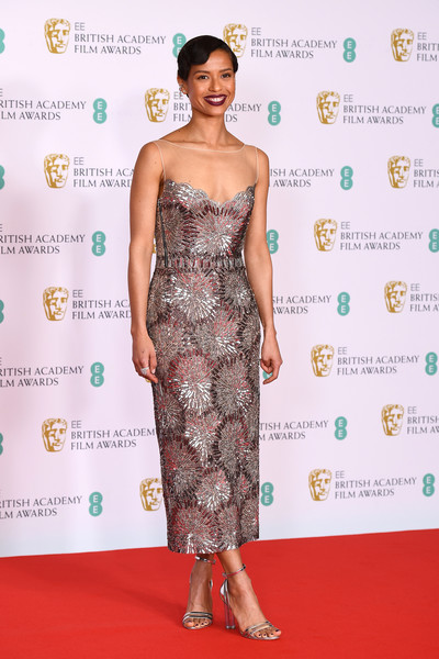 Gugu Mbatha-Raw Strappy Sandals [joint,hairstyle,smile,arm,shoulder,one-piece garment,white,dress,neck,waist,dress,gugu mbatha-raw,red carpet,model,joint,hairstyle,smile,ee,british academy film awards 2021 - arrivals,film festival,2013 toronto international film festival,red carpet,cocktail dress,fashion,gown / m,festival,film festival,dress,2013,model]