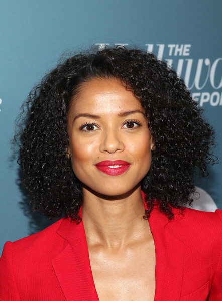 Gugu Mbatha-Raw Red Lipstick [hollywood reporter,hair,hairstyle,face,lip,eyebrow,forehead,black hair,chin,ringlet,jheri curl,power 100 women in entertainment - red carpet,power 100 women in entertainment,gugu mbatha-raw,california,los angeles,milk studios]