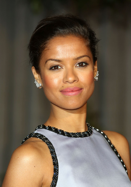 Gugu Mbatha-Raw Loose Bun [hair,face,eyebrow,hairstyle,beauty,lip,chin,black hair,forehead,smile,gugu mbatha-raw,ee,england,london,the grosvenor house hotel,party,british academy film awards,red carpet arrivals]