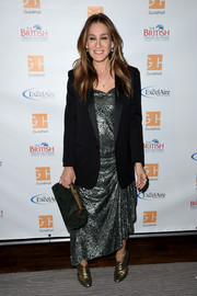 Sarah Jessica Parker pulled her ensemble together with a forest-green suede clutch by Mansur Gavriel.