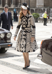 Princess Beatrice opted for a black-and-white geometric-patterned coat when she attended the Guildhall lunch.