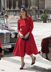 Princess Eugenie was a vision in a red Eponine fit-and-flare dress with cutouts along the neckline during the Guildhall lunch.