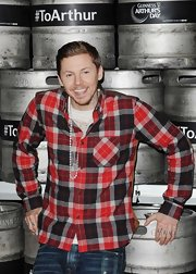 Professor Green looked vibrant in his colorful plaid flannel shirt during an Arthur's Day celebration.