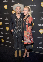 Ashlee Simpson arrived for the Guitar Hero Live launch wearing a stylish print coat.