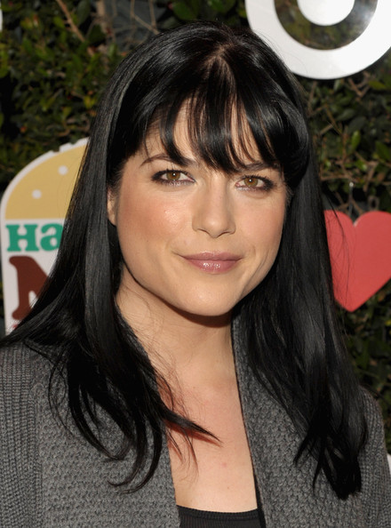 Selma Blair wore her long shiny tresses straight and with lash-grazing bangs at the launch of Harajuku Mini for Target.